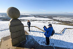 © Licensed to London News Pictures. 30/01/2019. Butlers Cross, UK.  Walkers pose for a photograph on a snow covered landscape on Coombe Hill in Butlers Cross, Buckinghamshire, as snow hits the south east of England. Photo credit: Ben Cawthra/LNP
