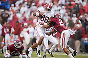FAYETTEVILLE, AR - OCTOBER 11:  O.J. Howard #88 of the Alabama Crimson Tide runs the ball and is hit by Alan Turner #27 of the Arkansas Razorbacks at Razorback Stadium on October 11, 2014 in Fayetteville, Arkansas.  The Crimson Tide defeated the Razorbacks 14-13.  (Photo by Wesley Hitt/Getty Images) *** Local Caption *** O.J. Howard; Alan Turner