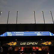 Arthur Ashe Stadium at dusk during the US Open. Flushing, New York, USA. 30th August 2013. Photo Tim Clayton