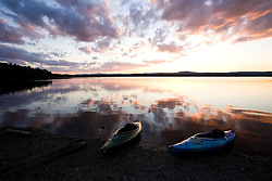 Kayaks at sunset on the shore of the Indian Pond section of the Kennebec River near Maine's Moosehead Lake.  Owned by Plum Creek.