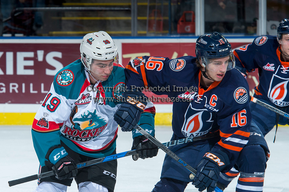KELOWNA, CANADA - FEBRUARY 24:  Nick Chyzowski #16 of the Kamloops Blazers checks Dillon Dube #19 of the Kelowna Rockets during first period on February 24, 2018 at Prospera Place in Kelowna, British Columbia, Canada.  (Photo by Marissa Baecker/Shoot the Breeze)  *** Local Caption ***