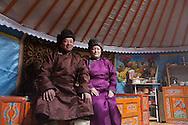Mongolia , portrait of Camel breeders  inside the ger, dressed with the del; the traditional mongol dress. family  in the Gobi desert  Bayanzag -  /portrait famille d'eleveur de chameau dans leur yourte,  habille en tenue traditionelle , le Del,  dans le desert de Gobi,   Bayan zag - Mongolie