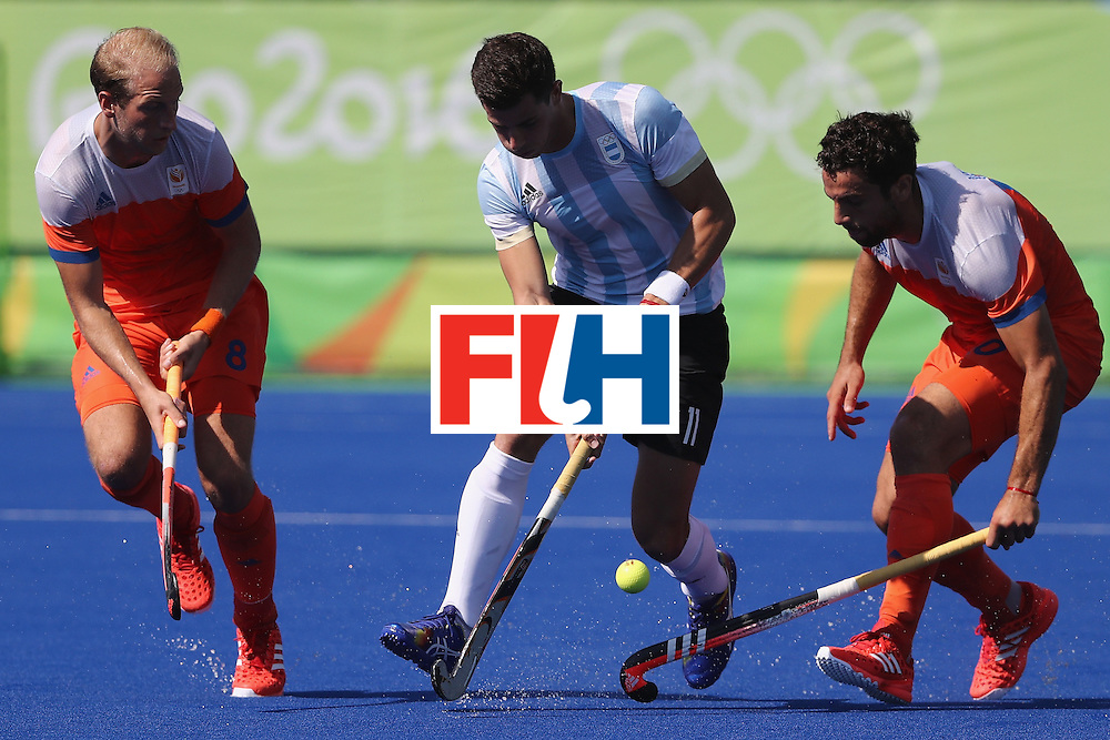 RIO DE JANEIRO, BRAZIL - AUGUST 06:  Joaquin  Menini #11 of Argentina competes against Billy Baker #8 and Valentin Verga #10 of Netherlands during at Olympic Hockey Centre on August 6, 2016 in Rio de Janeiro, Brazil.  (Photo by Sean M. Haffey/Getty Images)