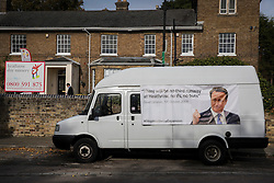 "© Licensed to London News Pictures. 27/10/2016. London, UK. A banner displayed on a van parked in the village of Harmondsworth, near Heathrow Airport, quotes former Prime Minister David Cameron's opposition to a third runway . The government has announced that a third runway will be built at the United Kingdom's busiest airport. The Cabinet are divided - with Foreign Secretary Boris Johnson saying that the project is ""undeliverable"". Conservative MP for Richmond Zac Goldsmith has resigned. Photo credit: Peter Macdiarmid/LNP"