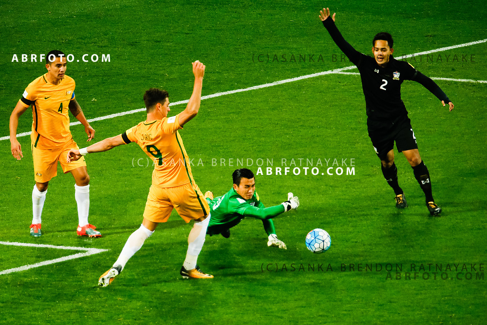 MELBOURNE, AUSTRALIA - SEPTEMBER 5 :  Sinthaweechai Hathairattanakool of Thailand punches the ball away as he dives during the Stage 3 Group World Cup Football Qualifiers between Australia Vs Thailand at the Melbourne Rectangular Stadium, Melbourne, Australia 5 September 2017.