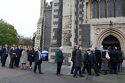 © Licensed to London News Pictures. 19/10/2012, London, UK. Leader of Labour Party Ed Miliband, third left, joins the queue to enter the church for a memorial service for the former energy minister and Croydon North Labour MP, Malcolm Wicks at  the Croydon Minster in Croydon, South London, Friday, Oct. 19, 2012. Malcolm Wicks had been suffering from cancer died aged 65 on September 29. Photo credit : Sang Tan/LNP