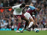 Photo: Lee Earle.<br /> West Ham United v Arsenal. The FA Barclays Premiership. 29/09/2007. West Ham's Lucas Neill (R) battles with Vassiriki Diaby.
