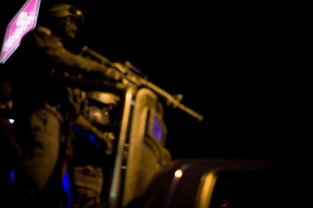 Federal Police respond outside of a hotel after a shoot out in Ciudad Juarez, Chihuahua on May 15, 2010.
