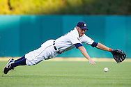 July 15, 2011; Detroit, MI, USA; Detroit Tigers second baseman Ryan Raburn (25) dives for a Chicago White Sox designated hitter Adam Dunn (32) tow RBI single during the third inning at Comerica Park.