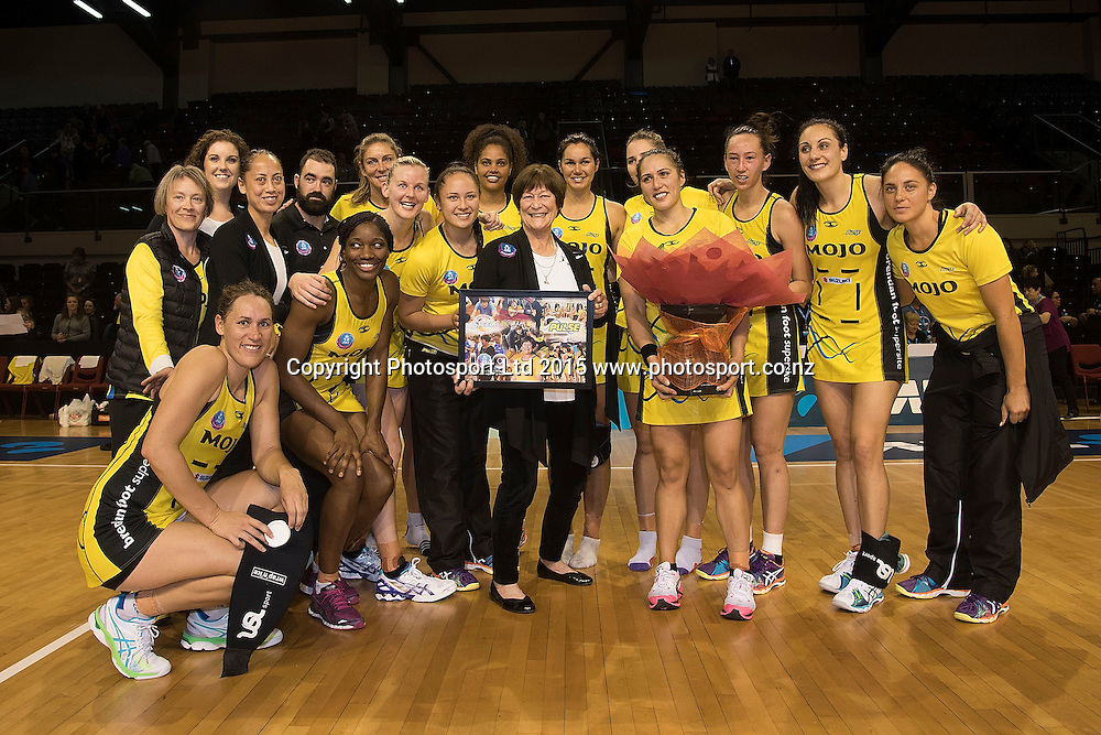 Head coach of the Pulse Robyn Broughton (C poses for a photo with her team after her 100th game during the ANZ Championship - Pulse v Fever netball match at the TSB Arena in Wellington on Monday the 19th of April 2015. Photo by Marty Melville / www.Photosport.co.nz
