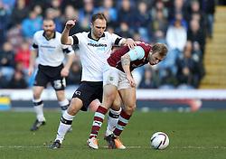 Derby County's John Eustace battles with Burnley's Scott Arfield - Photo mandatory by-line: Matt Bunn/JMP - Tel: Mobile: 07966 386802 22/02/2014 - SPORT - FOOTBALL - Turf Moor Stadium- Burnley - Burnley  v Derby County- Sky Bet Championship