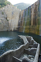 Scissors and cut marks painted on Matilija Dam and the defunct fish ladder in Los Padres National Forest near Ojai, California.