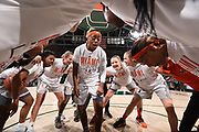 January 20, 2019: Taylor Mason #13 of Miami (center) motivates teammates Kelsey Marshall #20 and Laura Cornelius #1 (left) and Emese Hof #21 and Rebecca Ripley #23 (right) before the NCAA basketball game between the Miami Hurricanes and the North Carolina Tar Heels in Coral Gables, Florida. The 'Canes defeated the Tar Heels 76-68.