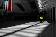 A WTC operation worker heads home at the Oculus of the World Trade Center transportation hub designed by Santiago Calatrava.