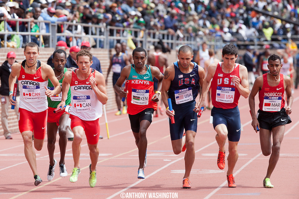The start of the USA vs. the World Men Distance Medley during the Penn Relays athletics meet Saturday, April 28, 2012 in Philadelphia, PA.