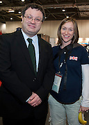 ..Dr. Stephen Farry Employment and Learning Minister for Northern Ireland with Team Leader Steph Tibbert  the ExCel Centre with entourage  in London on October 8th 2011.