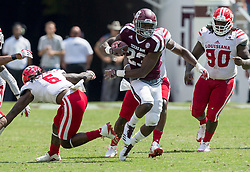 Texas A&M running back Jacob Kibodi (23) avoids a tackle by Louisiana-Lafayette defensive back Corey Turner (6) on his way to a 67 year touchdown run during the fourth quarter of an NCAA college football game Saturday, Sept. 16, 2017, in College Station, Texas. (AP Photo/Sam Craft)