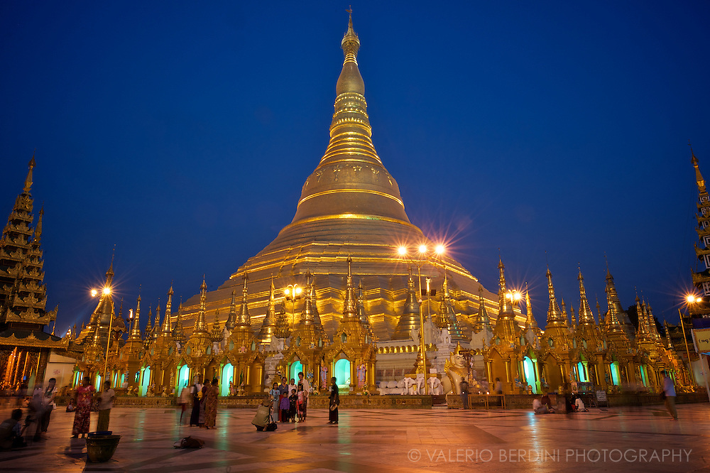 Pilgrims take family shots in front of the Shwedagon pagoda, the most sacred of the thousands of Buddhist temples in Burma.