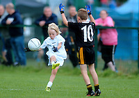20 Aug 2016: Fionnan Galvin, left, Kildare in action against Conor Sweeney, Kerry.  Gaelic U10 Boys, Kerry v Kildare.  2016 Community Games National Festival.  Athlone Institute of Technology, Athlone, Co. Westmeath. Picture: Caroline Quinn