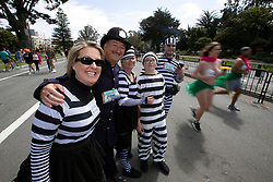 A cop and his robbers, from Rocklin, Calif., pose for a photo at the 107th running of the Bay to Breakers, Sunday, May 20, 2018, in San Francisco. (Photo by D. Ross Cameron)