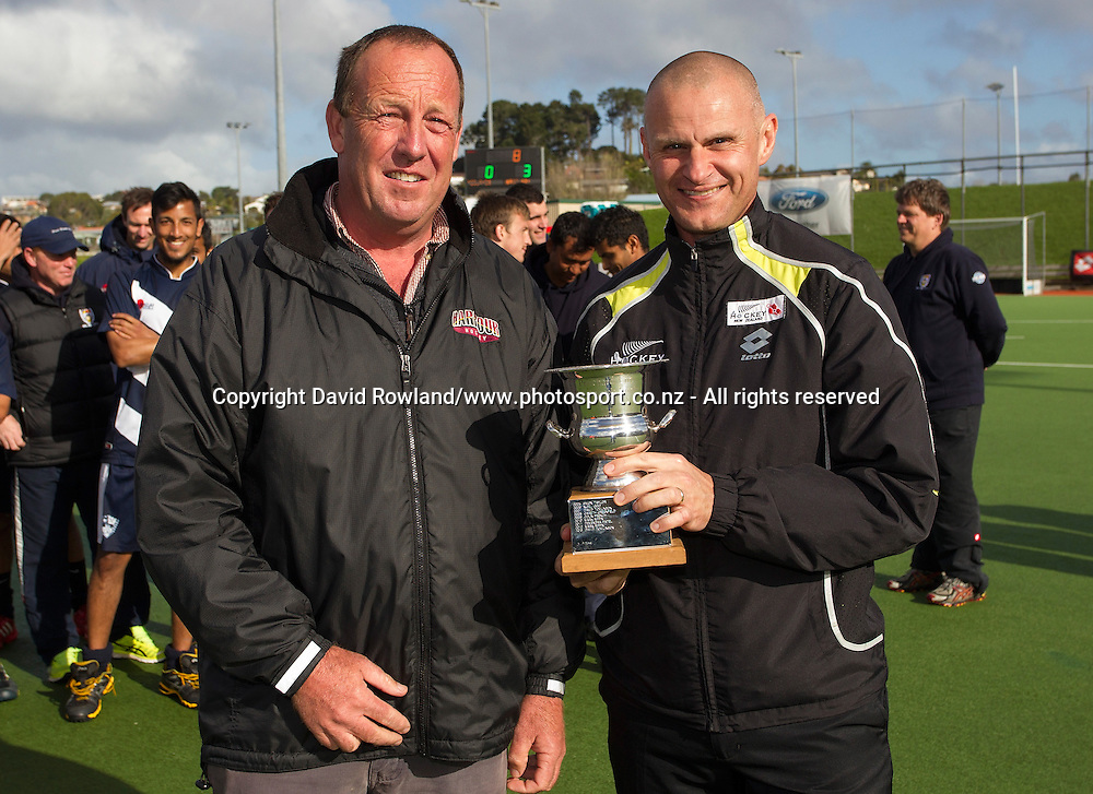 President of North Harbour Hockey Murray Goad presents Umpire Simon Taylor with the most valuable umpire of the tournament award after the Auckland v Midlands Men`s Final match, Ford National Hockey League, North Harbour Hockey Stadium, Auckland, New Zealand,Sunday, September 14, 2014. Photo: David Rowland/Photosport