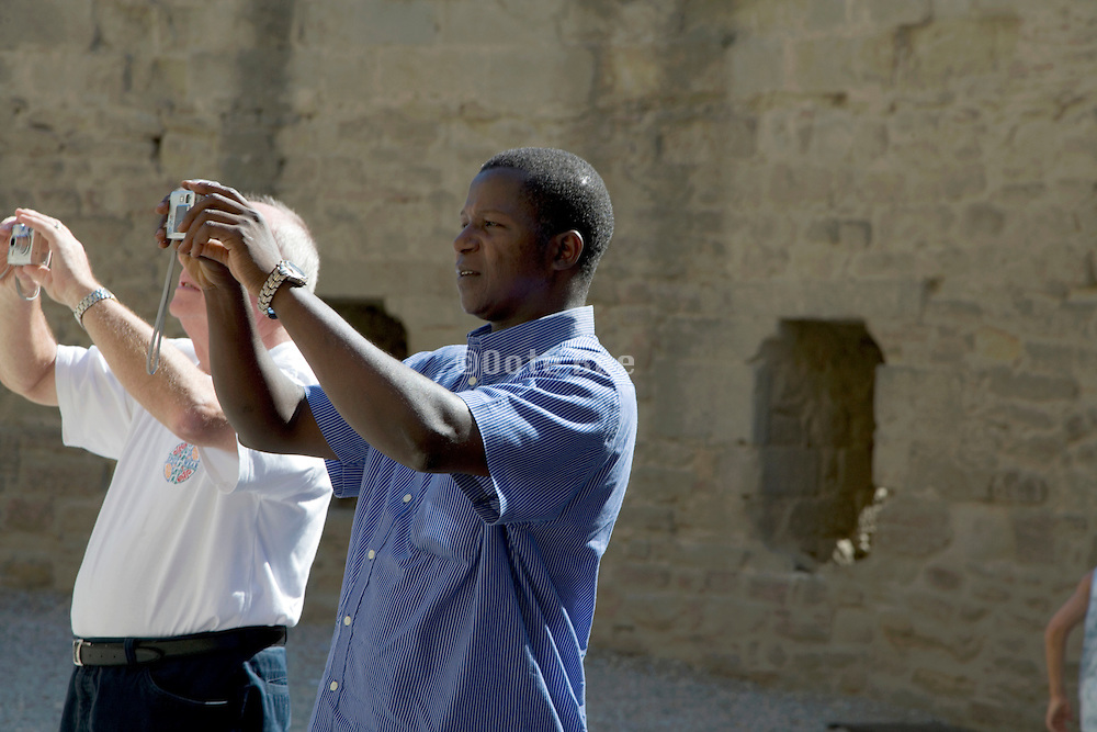 two tourists making a digital picture location South France
