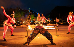 Edinburgh, Scotland, UK. 1 August, 2019. Preview opening night of the 2019 Royal Edinburgh Military Tattoo, performed on the esplanade at Edinburgh Castle. This is the Tattoo's 69th year and it runs from 2-24 August. Pictured The Trinidad and Tobago Defence force Steel Orchestra perform a limbo under fire
