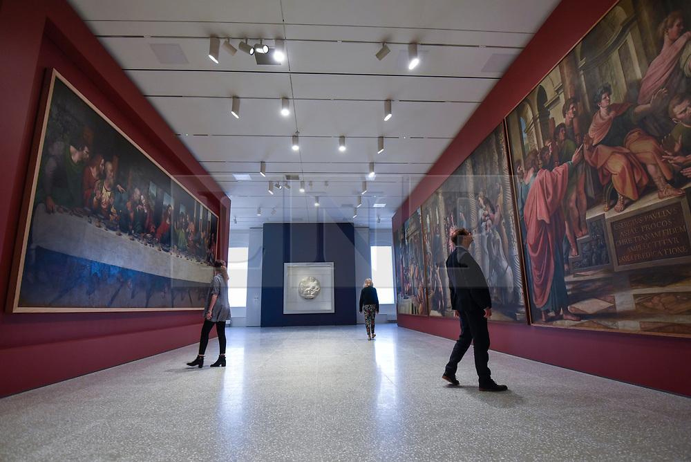 "© Licensed to London News Pictures. 14/05/2018. LONDON, UK. Gallery staff are seen in the new Collection Gallery viewing, (L to R) Leonardo Da Vinci 's ""The Last Supper"", copy made 1515-20, ""The Virgin and Child with the infant St. John"", 1504-05, by Michelangelo, and copies of Raphael's paintings, 1483-1520, made by Sir James Thornill, at a photocall for the opening of the new Royal Academy of Arts (RA) in Piccadilly.  As part of the celebrations for its 250th anniversary year, redevelopment has seen the RA's two buildings, 6 Burlington Gardens and Burlington House, united into one extended campus and art space extending from Piccadilly to Mayfair.  Photo credit: Stephen Chung/LNP"