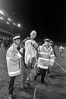 An injured English fan following the  riot at the Ireland v England at Landsdowne Road. Following the Irish goal a riot erupted and the game was abandoned. 15/2/1995 (Part of the Independent Newspapers Ireland/NLI Collection)
