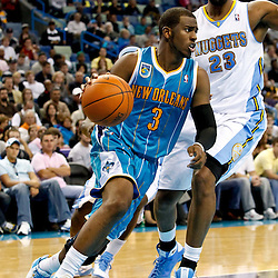October 29, 2010; New Orleans, LA, USA; New Orleans Hornets point guard Chris Paul (3) drives past Denver Nuggets power forward Shelden Williams (23) during the fourth quarter at the New Orleans Arena. The Hornets defeated the Nuggets 101-95.  Mandatory Credit: Derick E. Hingle