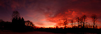 Dawn Morning Clouds. Winter Backyard Nature in New Jersey. In-camera (jpg) panorama taken with a Fuji X-T1 camera and 16 mm f/1.4 lens (ISO 200, 16 mm, f/5.6, 1/60 sec).