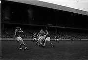 17/10/1965<br /> 10/17/1965<br /> 17 October 1965<br /> Oireachtas Final: Kilkenny v Tipperary at Croke Park, Dublin.<br /> Tipperary's J. Doyle (right) comes in to try to stop a clearance by Kilkenny goalie, O. Walsh (left).