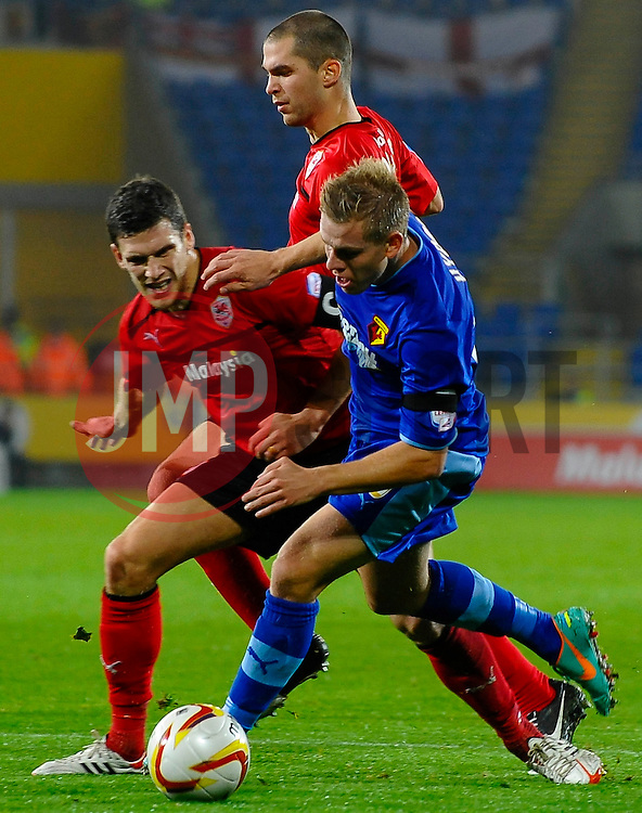Watford Forward Matej Vydra (CZE) is tackled by Cardiff Defender Mark Hudson (ENG) during the first half of the match - Photo mandatory by-line: Rogan Thomson/JMP - Tel: Mobile: 07966 386802 23/10/2012 - SPORT - FOOTBALL - Cardiff City Stadium - Cardiff. Cardiff City v Watford - Football League Championship