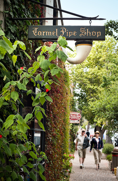 Tourists enjoy the character of Carmel, California shops and signs