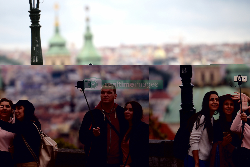 November 1, 2018 - Prague, Czech Republic - Tourists with mobiles taking selfie during autumn colors in Prague in Czech Republic. (Credit Image: © Slavek Ruta/ZUMA Wire)