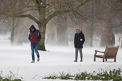 © Licensed to London News Pictures. 01/03/2018. London, UK. People brave the snow in St James Park on their way to work as severe weather continues in the capital. The 'Beast from the East' and Storm Emma have brought extreme cold and heavy snow to the UK. Photo credit: Rob Pinney/LNP