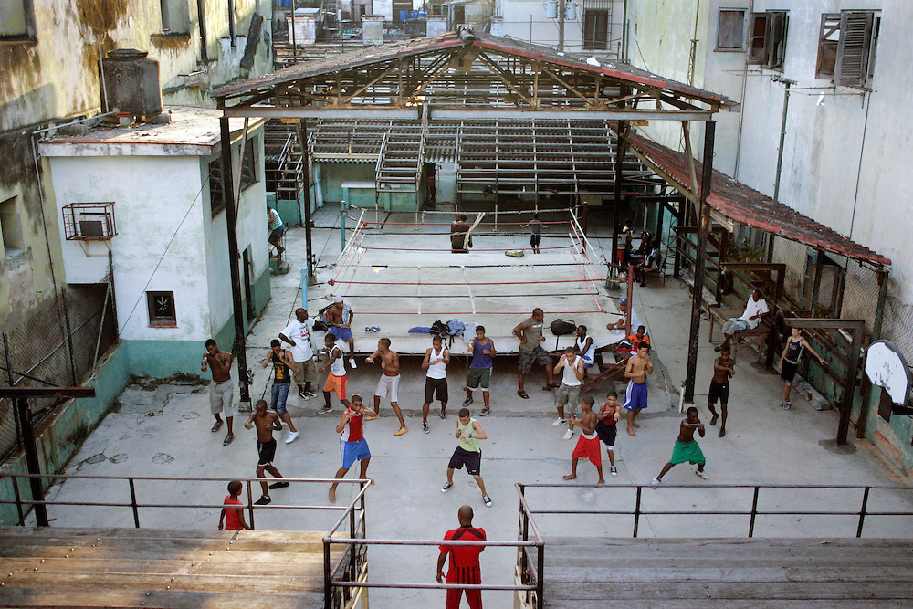 A group of boys warm up during a boxing school in an old ring in Havana, Cuba.