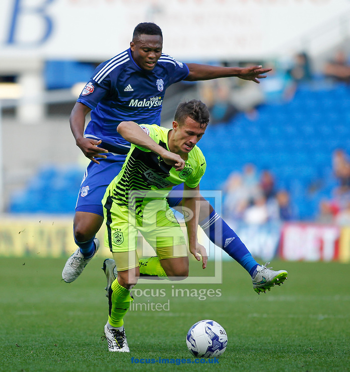 Kagisho Dikgacoi of Cardiff City and Jonathan Hogg of Huddersfield Town during the Sky Bet Championship match at the Cardiff City Stadium, Cardiff<br /> Picture by Mike Griffiths/Focus Images Ltd +44 7766 223933<br /> 12/09/2015