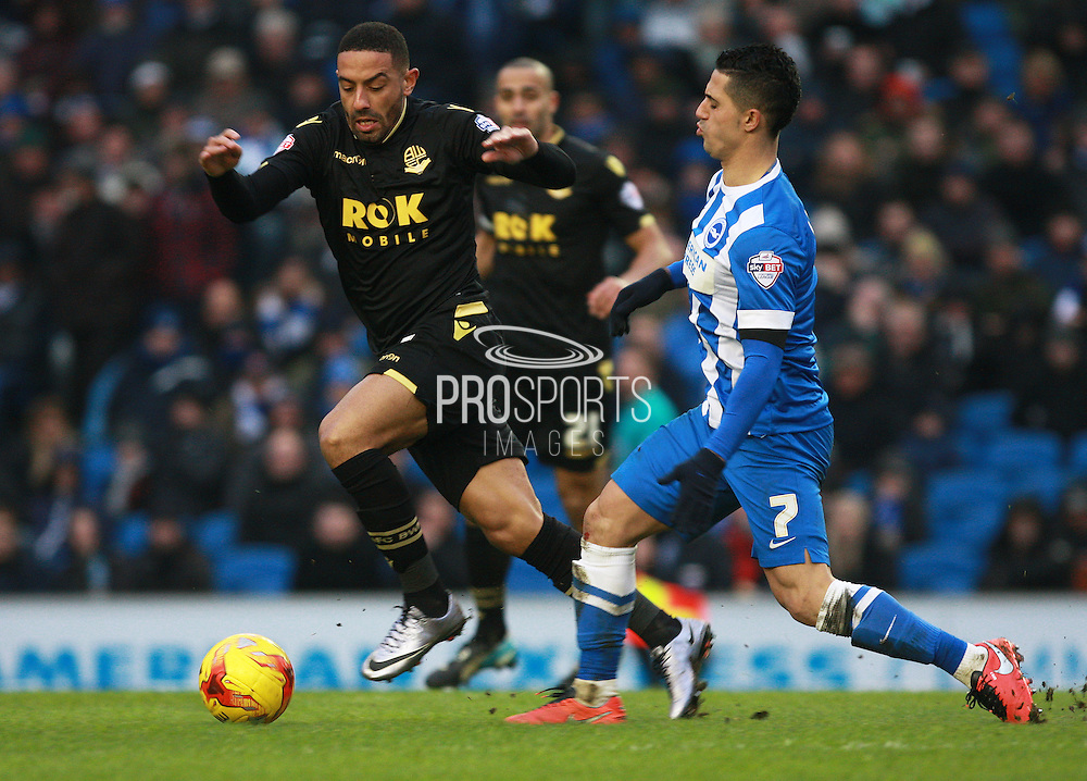 Bolton Wanderers midfielder Liam Feeney & Brighton central midfielder Beram Kayal compete for possession during the Sky Bet Championship match between Brighton and Hove Albion and Bolton Wanderers at the American Express Community Stadium, Brighton and Hove, England on 13 February 2016. Photo by Bennett Dean.