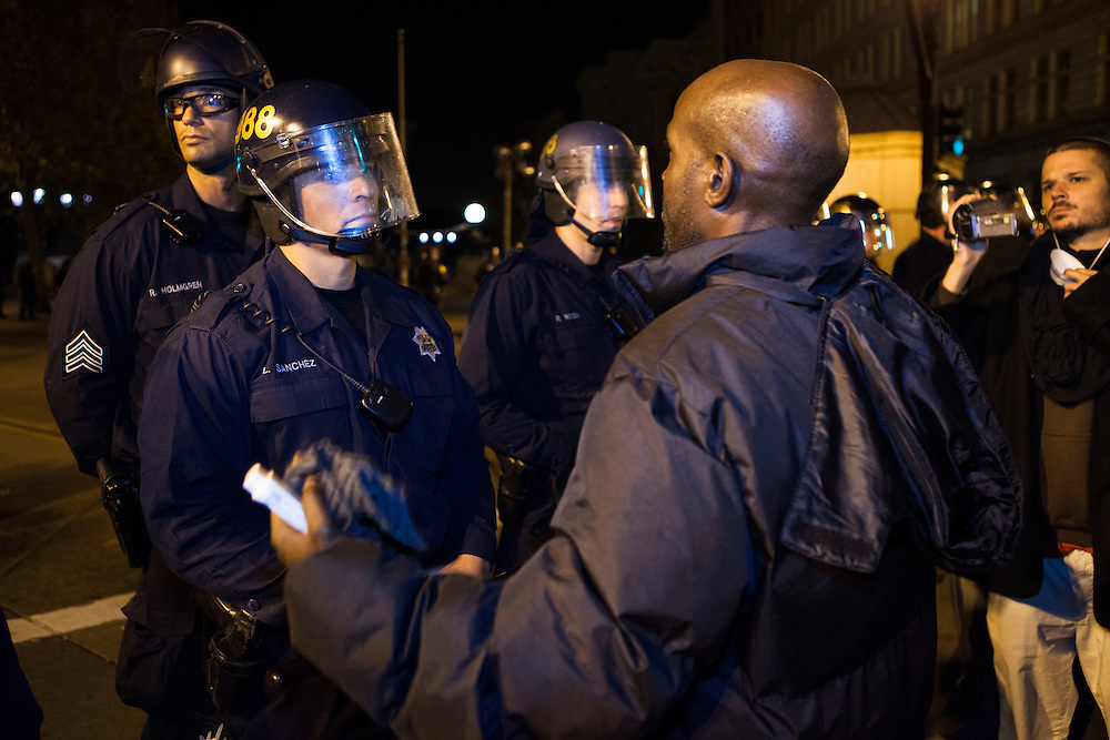 OAKLAND, CA - NOVEMBER 14, 2011: A protester confronts an officer, claiming to have been wrongfully arrested in the past by him and asks why he did it.