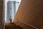 A Japanese man uses a smart phone as he descends some stairs near the Roppongi Hills tower, Roppongi, Tokyo, Japan. Monday April 22nd 2019