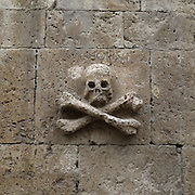 Stone skull in Castrojeriz. Burgos province . Spain . The WAY OF SAINT JAMES or CAMINO DE SANTIAGO following the French Route, between Saint Jean Pied de Port and Santiago de Compostela in Galicia, SPAIN. Tradition says that the body and head of St. James, after his execution circa. 44 AD, was taken by boat from Jerusalem to Santiago de Compostela. The Cathedral built to keep the remains has long been regarded as important as Rome and Jerusalem in terms of Christian religious significance, a site worthy to be a pilgrimage destination for over a thousand years. In addition to people undertaking a religious pilgrimage, there are many travellers and hikers who nowadays walk the route for non-religious reasons: travel, sport, or simply the challenge of weeks of walking in a foreign land. In Spain there are many different paths to reach Santiago. The three main ones are the French, the Silver and the Coastal or Northern Way. The pilgrimage was named one of UNESCO's World Heritage Sites in 1993. When there is a Holy Compostellan Year (whenever July 25 falls on a Sunday; the next will be 2010) the Galician government's Xacobeo tourism campaign is unleashed once more. Last Compostellan year was 2004 and the number of pilgrims increased to almost 200.000 people.