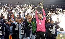 Dec 7, 2013; Kansas City, KS, USA; Sporting KC goalkeeper Jimmy Nielsen (in pink jersey) hoists the MLS Cup and celebrates with teammates after the 2013 MLS Cup against Real Salt Lake at Sporting Park. Mandatory Credit: Denny Medley-USA TODAY Sports
