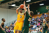 Vermont's Anthony Lamb (3) leaps over Lyndon's Robbie Rouelle (33) to take a shot during the men's basketball game between the Lyndon State Hornets and the Vermont Catamounts at Patrick Gym on Saturday afternoon November 19, 2016 in Burlington (BRIAN JENKINS/for the FREE PRESS)