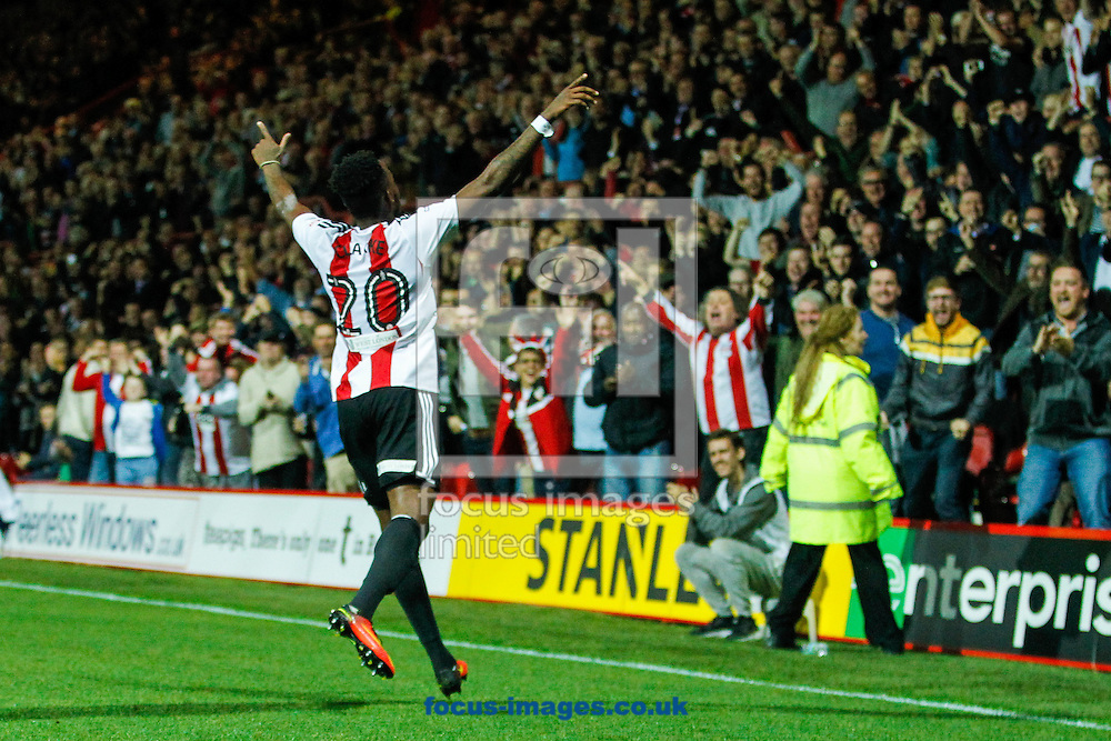 Josh Clarke of Brentford celebrates scoring the opening goal during the Sky Bet Championship match between Brentford and Reading at Griffin Park, London<br /> Picture by Mark D Fuller/Focus Images Ltd +44 7774 216216<br /> 27/09/2016