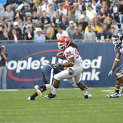Oct 31, 2009; East Hartford, CT, USA; Rutgers running back Jourdan Brooks (39) runs through a tackle by Connecticut cornerback Robert McClain (42) during first half Big East NCAA football action between Rutgers and Connecticut at Rentschler Field.