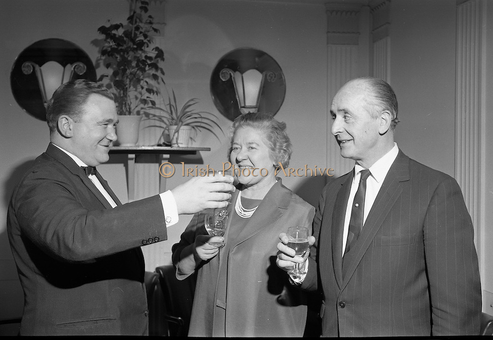 Toddie O'Sullivan announces that he will retire from the management of the Gresham Hotel at the end of the financial year. Picture shows Mr. and Mrs. O'Sullivan being toasted by the Chief of Banquetry, Mr. Vincent Tynan. Picture shows Mr. O'Sullivan and his wife.<br /> 07.03.1968