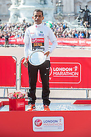 Tito Sena of Brazil winner of the men's T44-46 IPC race with his salver at the Virgin Money London Marathon 2014 at the finish line on Sunday 13 April 2014<br /> Photo: Dillon Bryden/Virgin Money London Marathon<br /> media@london-marathon.co.uk