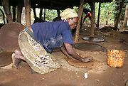 Africa, Ethiopia, Omo region, Ari village. Woman prepares bread from the shaving a leaf of the fruitless Banana. These shavings are a major ingredient in the local bread