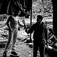 """Ernesto Ezpeleta """"Bihurri"""", wood cutter or aizkolari in Basque language. He teaches how to cut wood to his son Odehi near his home in Mendaro. Basque rural sports (Herri Kirolak in basque language) are rooted in traditional lifestyles, mostly farmer occupations of the Basque Country, in Northern Spain. Nowadays they have transform themselves into sports based in strenght and skill. Stone lifting and wood chopping are the most popular."""
